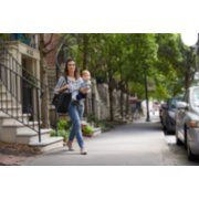 mom carrying child and city suite playard in bag image number 11