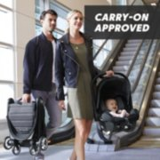 Mom carrying carry on approved car seat and dad with stroller image number 1