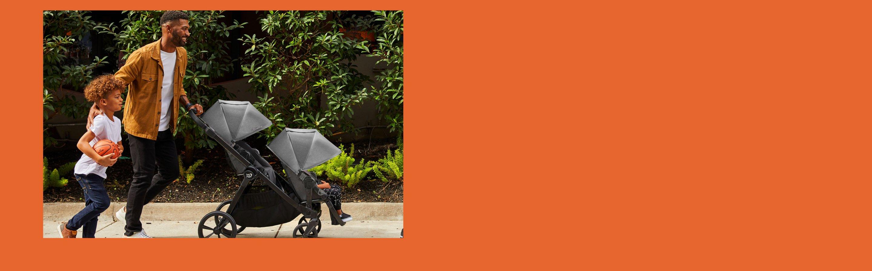family pushing stroller banner