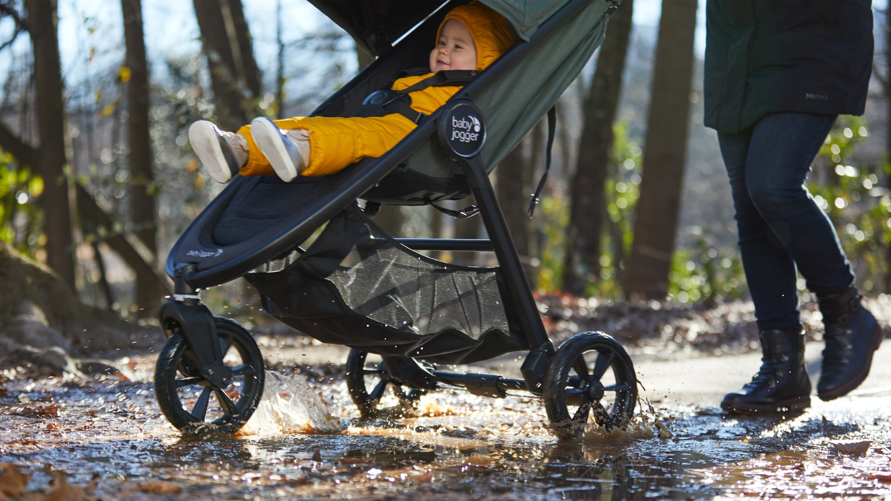stroller going through mud and leaves in fall season