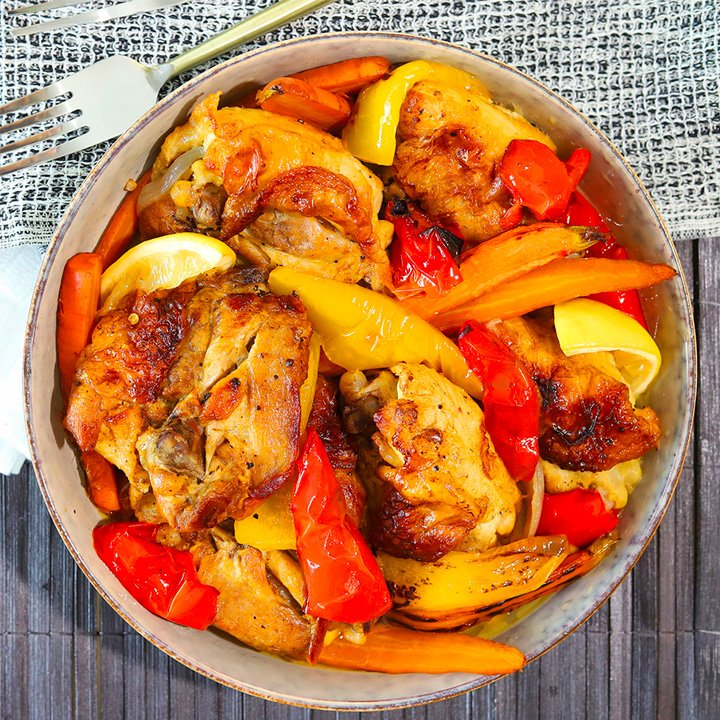 prepared meal in bowl with meat and peppers