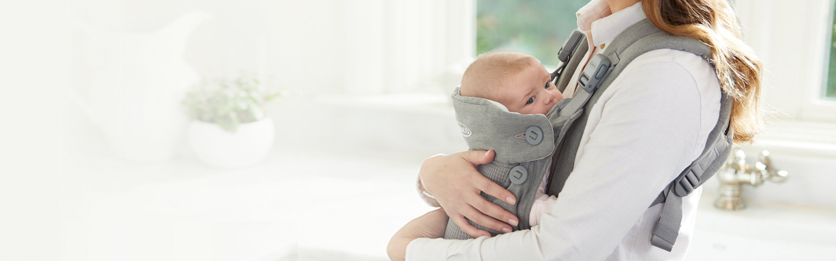 baby being held in carrier