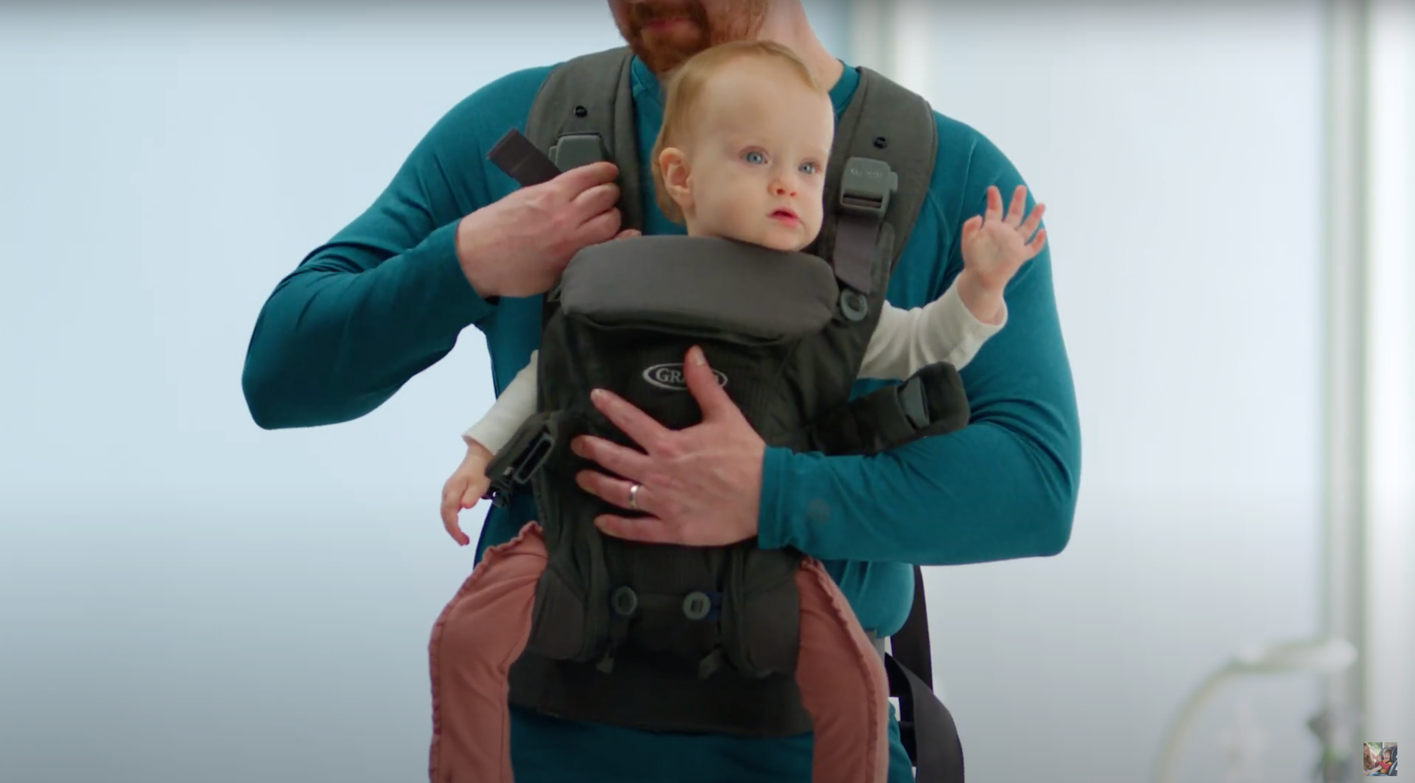 baby being secured inside carrier