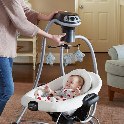 Baby rocker with hanging toys