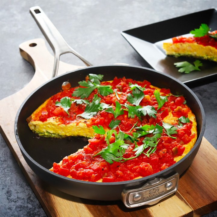 chicago style pizza prepared inside pan