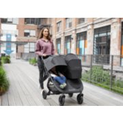 Mother pushing city mini GT2 double stroller with child image number 9